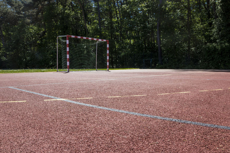 Goa!! Curve Football Lines Playing Games Court Day Empty Goal No People Outdoors Play Playground Playing Field Red Color Soccer Soccer Field Sport Sunny Day Tree White