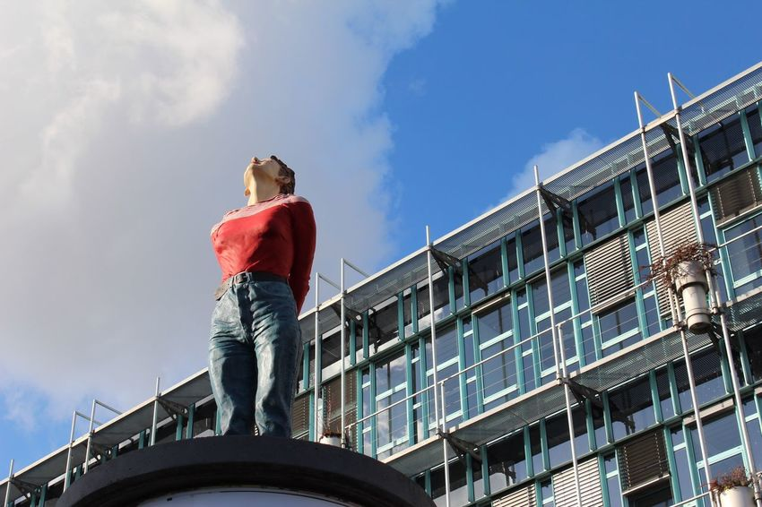 Low Angle View Day Architecture One Person Standing Building Exterior Built Structure Outdoors Cloud - Sky Sky Lifestyles Real People Women Men Young Adult City Adult Adults Only People Herbst17 🦋 Autumn🍁🍁🍁 Autumn17 Postcode Postcards Modern Architecture
