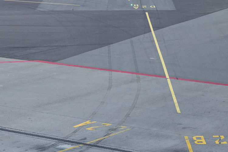 Paint The Town Yellow Airplane Airport Airport Runway Asphalt Cordon Tape Dividing Line High Angle View LINE Marking Outdoors Road Road Marking Runway Transportation Yellow