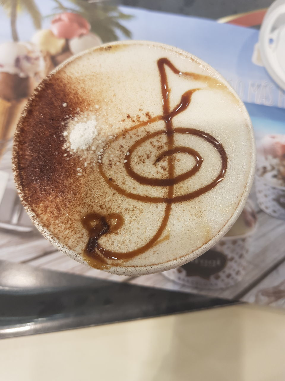 CLOSE-UP OF COFFEE CUP WITH CAPPUCCINO