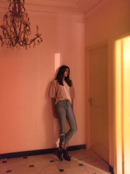 Light Play Chandelier Neon Lights Light Full Length One Person Home Interior Indoors  Casual Clothing Real People Young Adult Architecture Standing Beautiful Woman Home Showcase Interior
