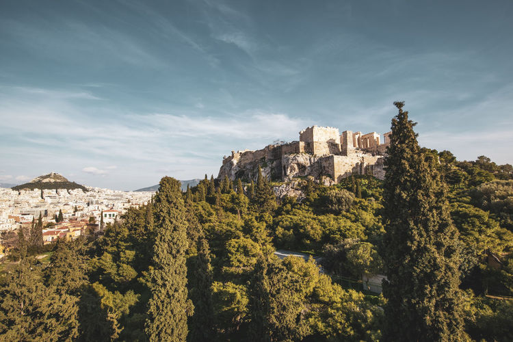 Athens Athens Greece Athens, Greece Acropolis Architecture Built Structure Sky Building Exterior Tree Building Nature Plant No People History The Past Day Mountain Cloud - Sky Outdoors Castle Growth Old Fort Residential District