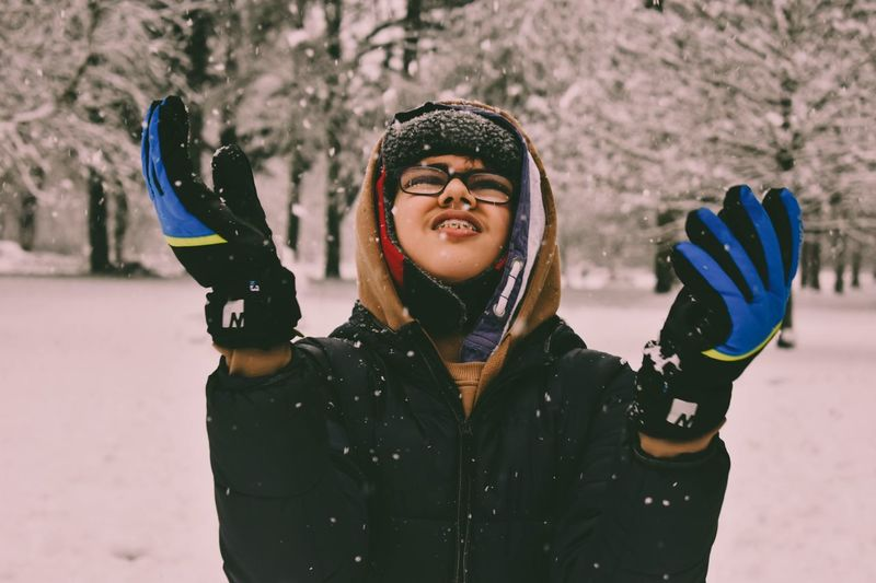 Christmas Winter Cold Temperature Snow Lifestyles Leisure Activity Warm Clothing Happiness Young Adult Jacket Smiling Front View Fun Real People Ski Goggles One Person Scarf Cheerful Enjoyment