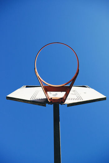 Blue Basketball - Sport Clear Sky Sky Basketball Hoop Low Angle View Sport Circle Nature Day Geometric Shape Shape Sunlight No People Copy Space Metal Outdoors Sunny Net - Sports Equipment Directly Below