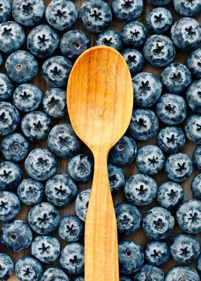 Rustic Wooden Spoon On Blue Berries