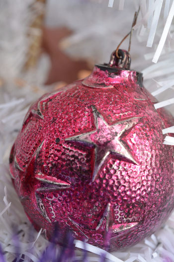 vintage metal Christmas ball ornament with raised star pattern hanging on white Christmas tree Christmas Decoration Christmas Decorations Christmas Ornament Christmas Tree Christmastime Close-up Day Holiday No People Ornament Red Retro Styled Vintage Christmas Decorations