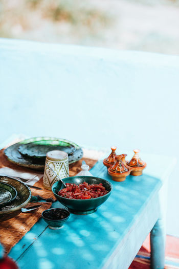 Moroccan food and dining Morocco Moroccan Moroccan Food Food And Drink Dining Dining Ware Table Chairs mealtime Bright Outdoors Colorful Cuisine Food Focus On Foreground Freshness Plate No People Water Bowl Day Nature Healthy Eating Kitchen Utensil Wellbeing Selective Focus Close-up Still Life Ready-to-eat Swimming Pool Tray Crockery