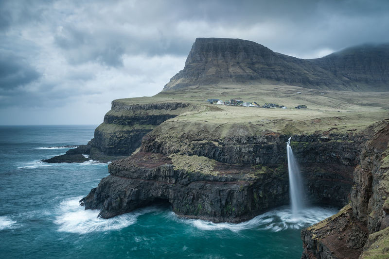 Gasadalur Waterfall Beauty In Nature Cloud - Sky Day Faroe Islands Faroeisland Faroeislands Gasadalur Horizon Over Water Idyllic Motion Mountain Nature No People Outdoors Power In Nature Scenics Sea Sky Storm Tranquil Scene Tranquility Travel Destination Travel Destinations Water Waterfall EyeEmNewHere