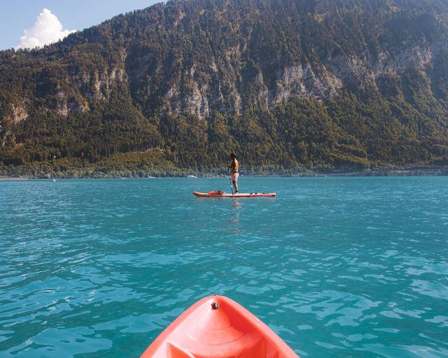 Full length of man paddleboarding in lake