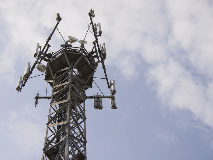 Low angle view of repeater tower against sky