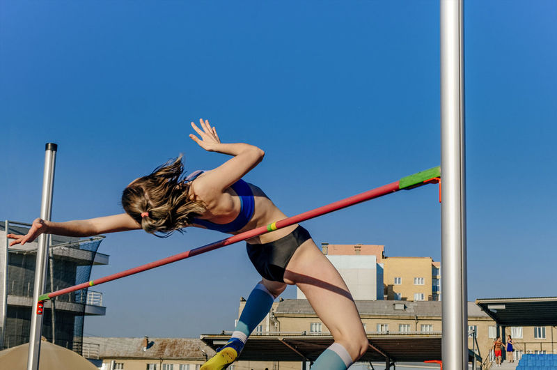 Female athlete high jump at athletics competition