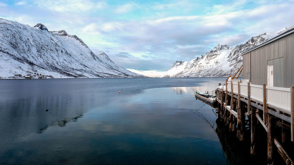 Tranquil glacial lake of Ersfjordbotn in Norway. #Ersfjordbotn #Panorama #arctic #bluesky #fjord #fjordsofnorway #glacial #glacier #glacierlake #landscape #landscapephotography #norway #scandi #scandinavia #tromso Day Ice Idyllic Lake Nature Outdoors Reflection Sky Snow Winter