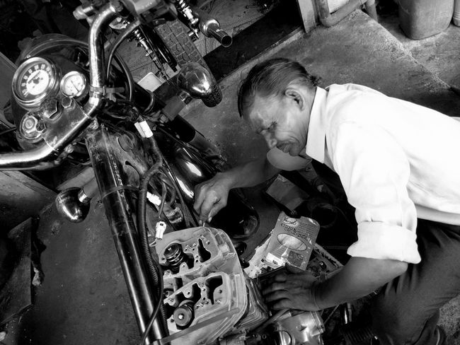 Engine Repair Motorcycle Maintenance Royal Enfield Working With Hands Street Photography Motorcycles Dramatic Angles Black And White