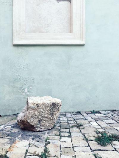 Stone window on water