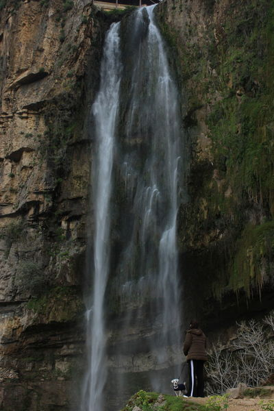 Beauty In Nature Cliff Day Dog Jezzine Lebanon Lifestyles Long Exposure Motion Nature One Person Outdoors People Power In Nature Real People Rock - Object Scenics Sky Tourism Travel Destinations Vacations Water Waterfall Women