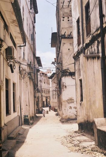 Stone Town really is an enigma wrapped up in a mystery. Shot on Kodak Gold 200! Filmisnotdead Canonae1 Zanzibar Tanzania 35mm Film 35mm Building Exterior Architecture Building Residential District Adventures In The City First Eyeem Photo