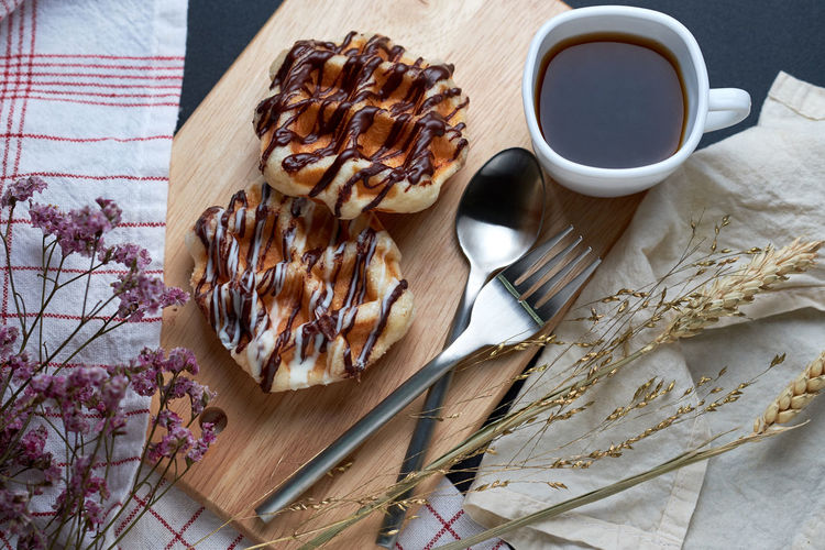 Baked Black Coffee Breakfast Close-up Cutlery Day Decoration Food French Food Freshness Indoors  No People Ready-to-eat Refreshment Spoon Sweet Food Table Waffle