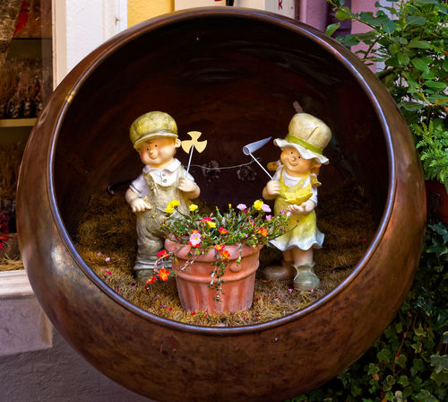 Copper Jar Art And Craft Close-up Day Doll Dolls Figurine  Flower Flowers In Pot Human Representation Male Likeness No People, Outdoors Potted Plant Sculpture Statue Toy