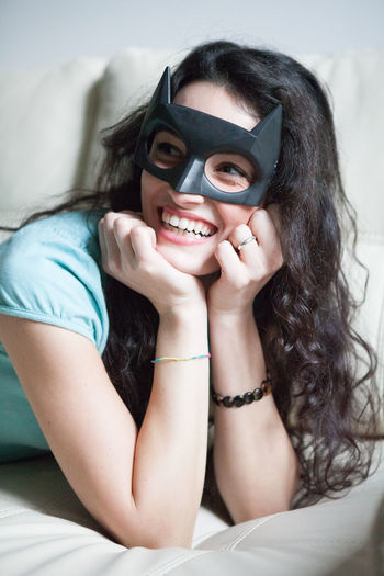 A girl on a couch smile with a batman mask Batgirl Batman Beauty Beauty Girl Casual Clothing EyeEm Best Edits EyeEm Best Shots EyeEm Gallery EyeEmBestPics Front View Girl Happiness Leisure Activity Lifestyles Looking At Camera Person Portrait Sitting Smiling Three Quarter Length Toothy Smile Waist Up Woman Young Adult Young Women