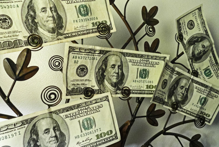 Paper Currency Business Finance Currency Wealth Human Representation Indoors  Corporate Business Representation Investment No People Gambling Success Large Group Of Objects Male Likeness Backgrounds Arts Culture And Entertainment Making Money Economy Dollar Sign