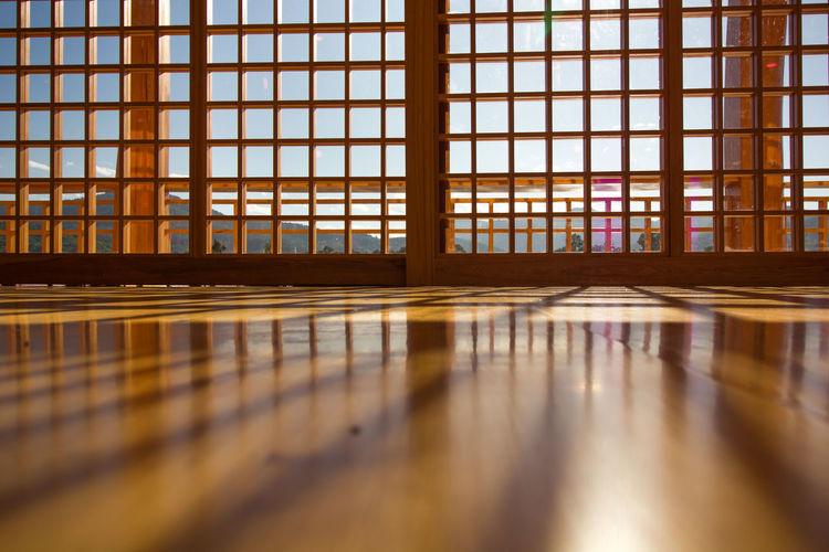 Reflection of window on glass floor