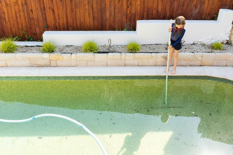 Full length of man standing in swimming pool