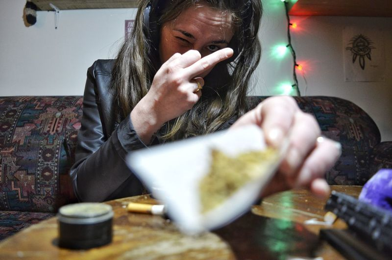 Addiction Young Women Close-up Bad Habit Unhealthy Living Smoking Cannabis - Narcotic Marijuana - Herbal Cannabis Smoking - Activity Cannabis Plant Smoking Issues Medical Cannabis Marijuana Joint Cigarette Lighter International Women's Day 2019