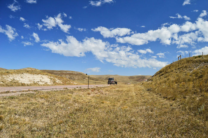 Trucking down lonely road Grass Hills South Of Manville Wyoming Outdoors Clouds And Sky Blue Color Sunshine Truck Highway Motion Landscape Cloud - Sky Two Lane Highway
