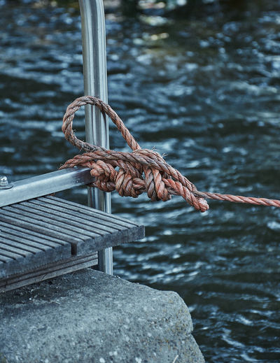 Knotted rope holding a boat Rope Close-up Day Focus On Foreground Hanging Knot Lake Marine Metal Nature No People Outdoors Protection Rock Rope Rusty Safety Security Solid Strength Tied Up Water