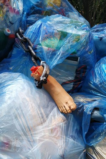 Broken mannequin on garbage