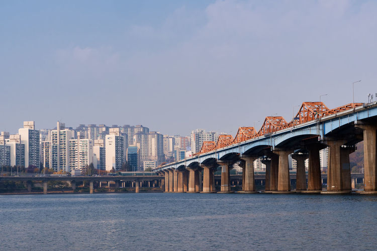A wide picture of dongho bridge over the han river from the riverside