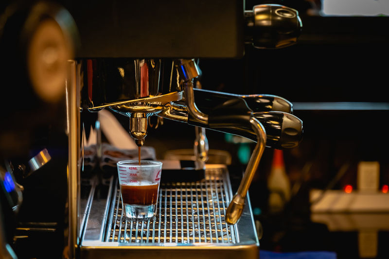 Food And Drink Drink Refreshment Coffee Coffee Maker Indoors  Focus On Foreground Coffee - Drink Machinery Cafe Alcohol Bar - Drink Establishment Glass Freshness Pouring Drinking Glass Close-up Household Equipment Appliance No People Coffee Shop Bar Counter