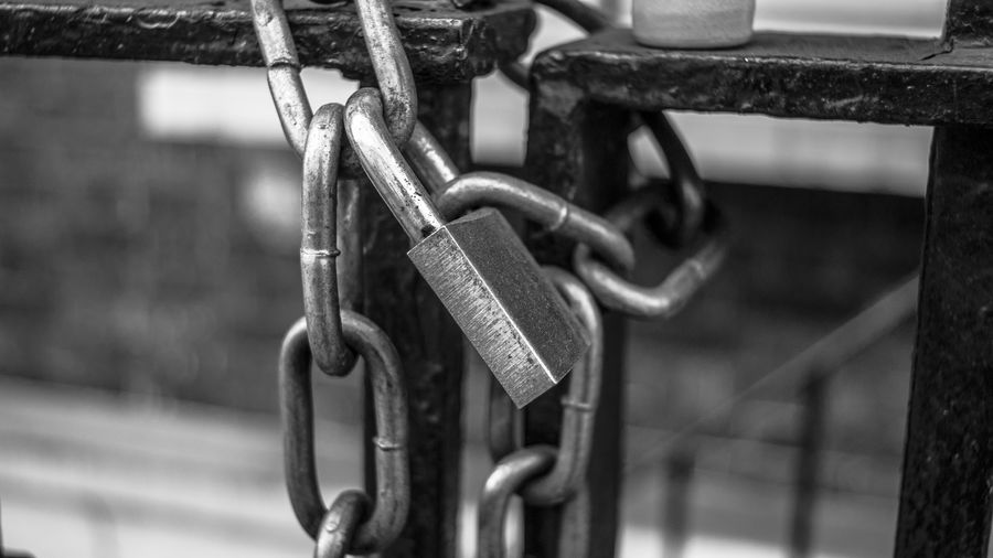 Close-up of padlocks on metal chain
