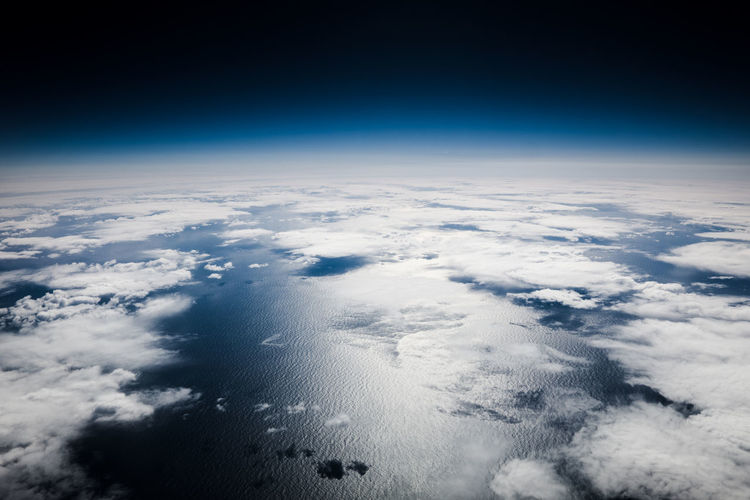 Cloud - Sky Sky Space Planet Earth Aerial View Cloudscape Planet - Space Satellite View Blue Nature Atmosphere Environment High Up Meteorology Urban Skyline No People Scenics - Nature Dark Dark Blue Above Outdoors Wind