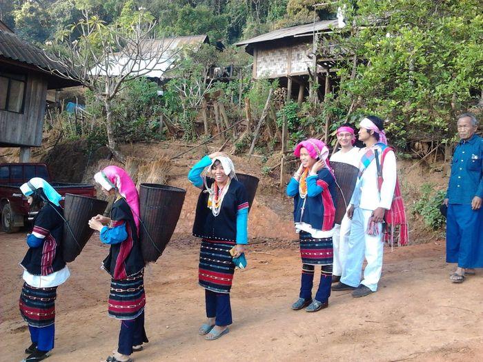 ประเพณีเผ่าละว้า Celebration Multi Colored Real People Lifestyles Outdoors Tree Day Women Leisure Activity Happiness People Togetherness Adult Adults Only Men Performance Clown Powder Paint Participant Holi
