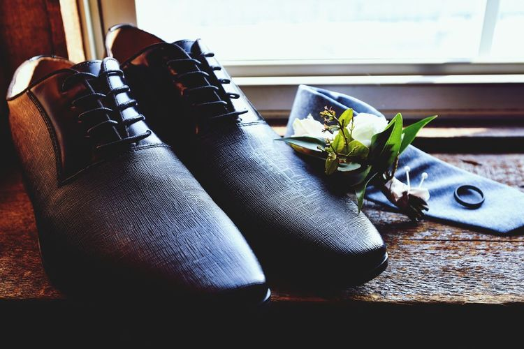 wedding day grooms shoes with ring Wedding Wedding Photography Wedding Groom Wedding Shoes Ring Wedding Shoes And Ring Low Section Home Interior Shoe Living Room Table Close-up Wooden Floor Pair Window Sill