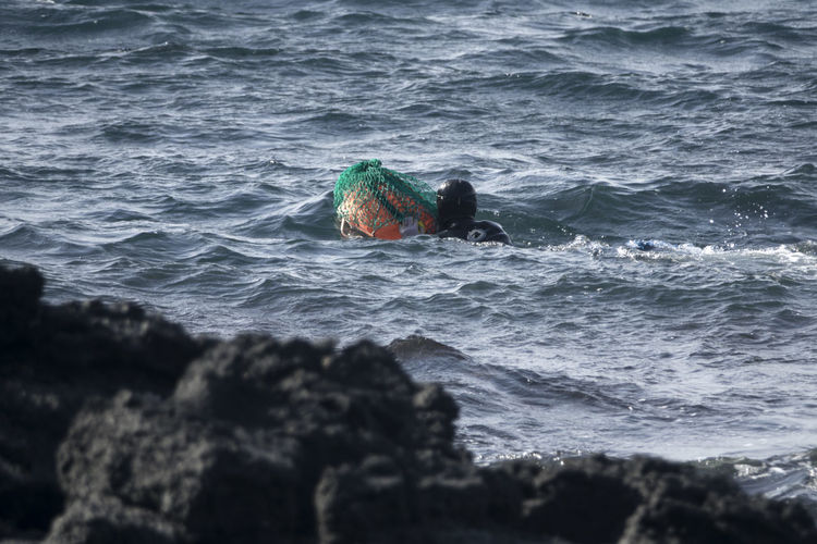 Haenyeo whod is a female diver for picking up sea food in sea Diving JEJU ISLAND  Swimming Beauty In Nature Day Female Diver Haenyeo Nature Outdoors Real People Sea Water Wave