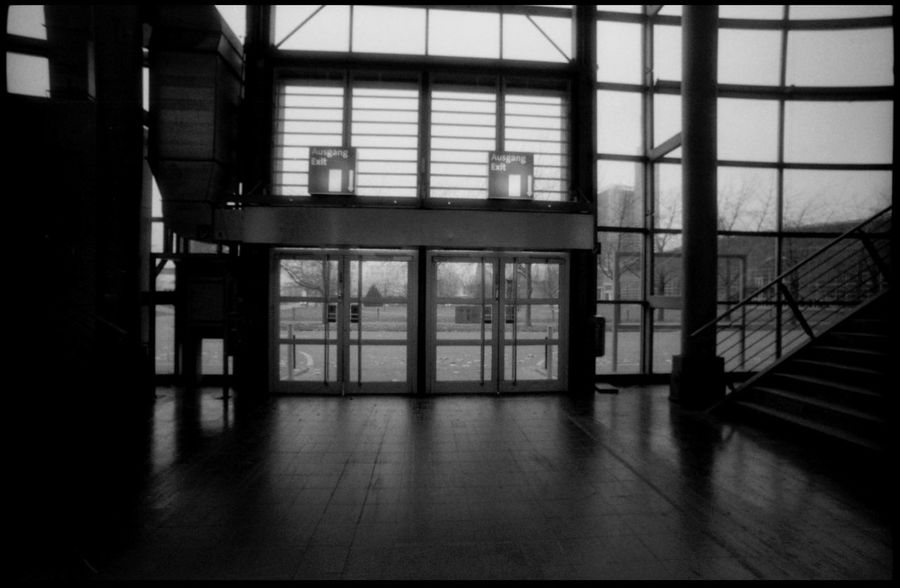 Messe Hannover, the ground of EXPO 2000 35 Mm Film Analogue Photography Architecture Black Cubic Architecture Downwards Empty Expo Expo 2000 Hall Hannover Light Messe Hannover Photographer Shadow Signs Silhouette Trade Trade Fair Vastness Windows