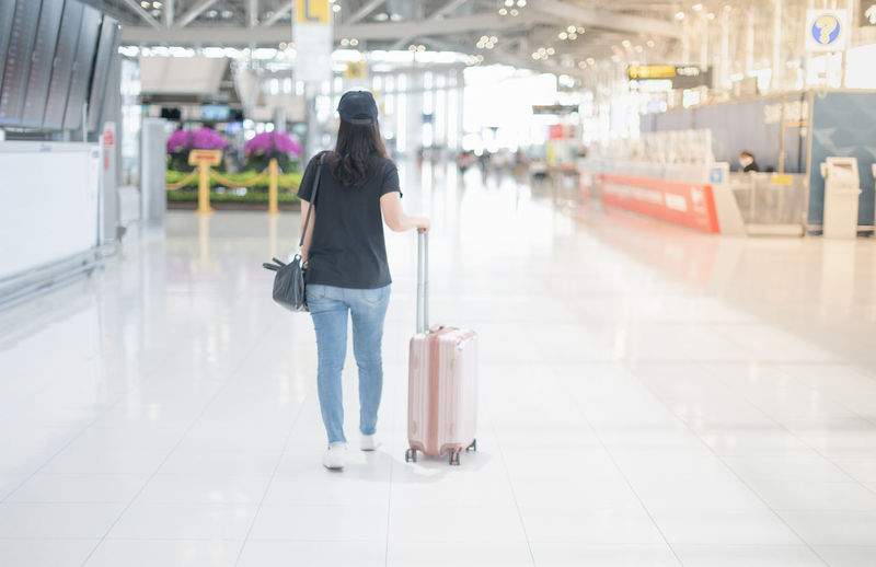 Rear view of woman walking in airport