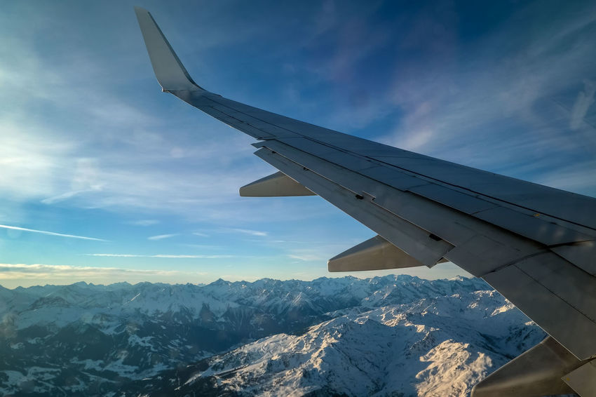 looking out of a window in an airplane and see the wing and beautyfull landscape Aiplane Air Vehicle Airplane Airplane Wing Beauty In Nature Beutyfull Cloud - Sky Day Flying Mountain Nature No People Outdoors Scenics Sky SnW Sun Travel Travel Destinations TravelNL