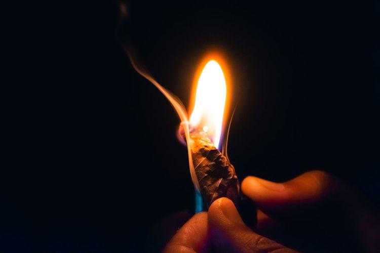 Fire source Fire Burning Flame Fire - Natural Phenomenon Heat - Temperature Human Hand Hand Close-up Illuminated Black Background Body Part Holding Glowing Dark Studio Shot Lighting Equipment Finger Lighter Kindle Fire Origins Fire Fireworks