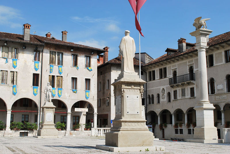 The heart of the city: Piazza Maggiore - Feltre, Belluno, Italy. Belluno City Feltre Italia Square Travel Architectural Column Architecture Building Exterior Day Europe Flag Italy No People Old Outdoors Sculpture Statue Tourism Travel Destinations Urban Veneto