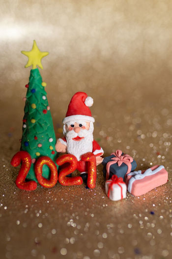 Close-up of figurine on christmas tree