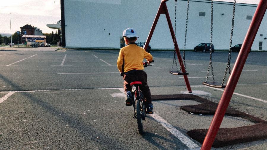 Boy Cycling On Road