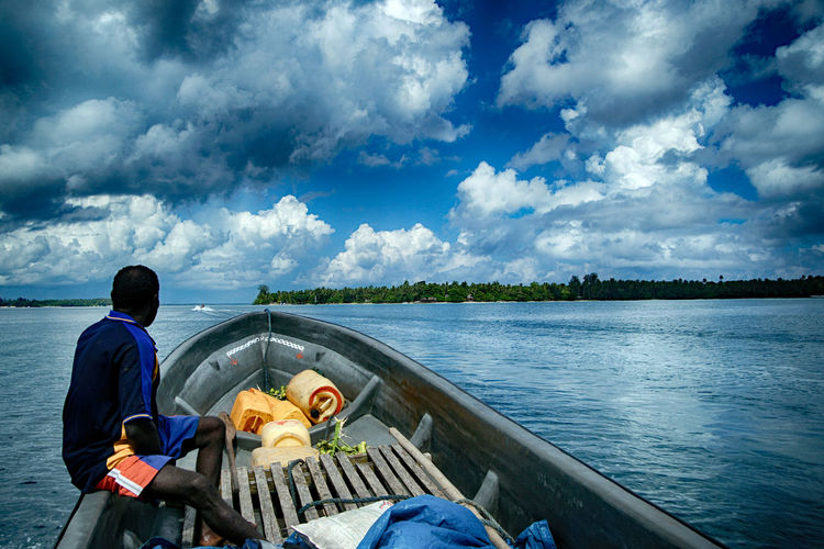 Cloud - Sky Water Sky Real People Sitting Transportation Beauty In Nature Nature One Person Day Lake Leisure Activity Lifestyles Men Mode Of Transportation Scenics - Nature Outdoors Nautical Vessel Looking At View