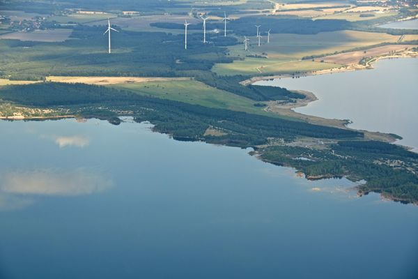 Aerial Shot Aerial View Composition From An Airplane Window Journey Lake Light And Shadow Outdoors Power In Nature Seascape Top Perspective Traveling Water Windmill