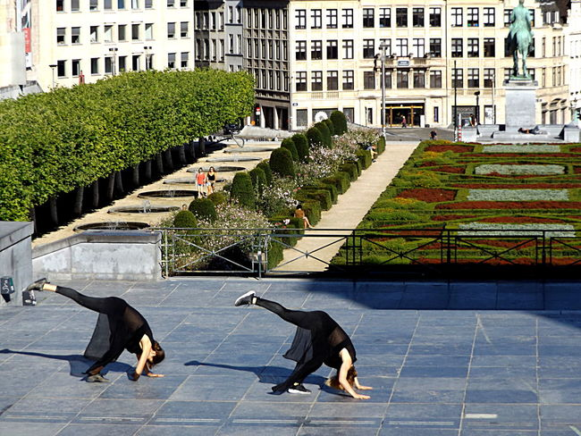 Act 9. Dancers Group Of People Duo Light And Shadow Visitbrussels Outdoors Movement In The Picture Mouvement Artistique City City Life Architecture Showing Emotion Streetphotography Front View Public Places Young Women Togetherness Garden Two Is Better Than One