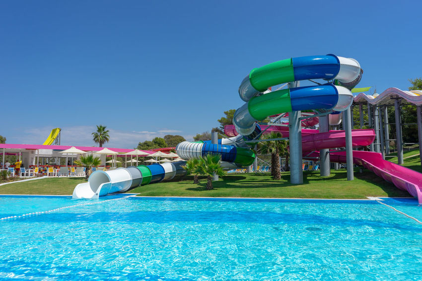 Summer Vacation Vacations Amusement Park Blue Clear Sky Day Enjoyment Fun Inflatable  Nature No People Outdoors Pool Sky Slide - Play Equipment Summer Sunlight Swimming Pool Tourist Resort Trip Tube Turquoise Colored Water Water Park Water Slide