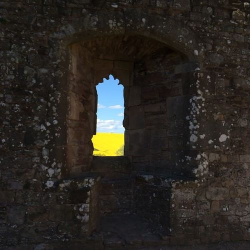 Raglan Castle. Monmouthshire. South Wales Raglan Castle Wales View Through The Window Field Of Rapeseed Blue Sky Yellow Fields Castle The Essence Of Summer Art Is Everywhere