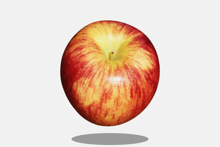 Directly above shot of apple against white background